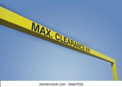 symbol sign maximum clearance height warning yellow bar diagonal blue sky background