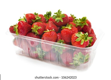 Symbol of summer, a punnet of delicious fresh strawberries on white.