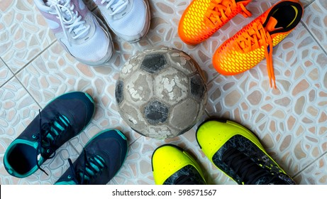 Symbol of Teamwork, Many shoes with ball on ground