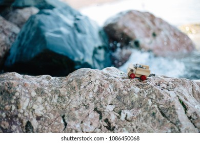Symbol of travel, adventure and dreams. Miniature wooden off road truck full of rocks