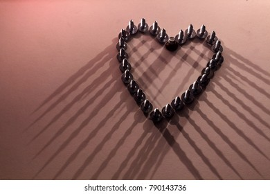 The symbol of unhappy love is a wounded heart, conceptual photography