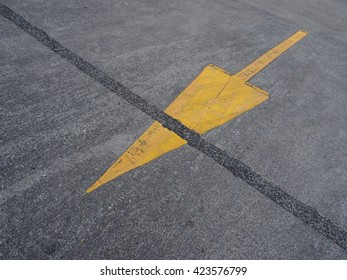 Symbol yellow arrow on the road.