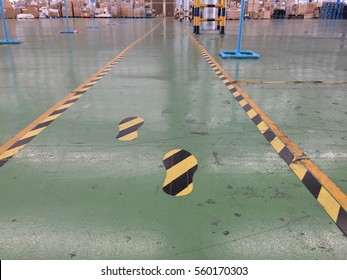 Symbol yellow and black are walkway on green floor in warehouse for safety