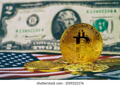 A symbolic coins of bitcoin on banknotes of one hundred dollars. bitcoin cash for a dollar.