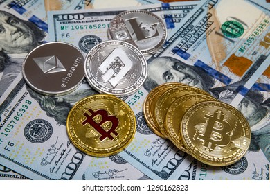 symbolic coins of bitcoin on banknotes of one hundred dollars. Exchange bitcoin cash for a dollar.