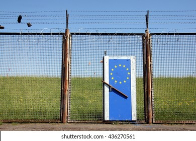 Symbolic European Border illustrating Europe's doors are closed (The barbed wire fence is not at the European border. It's a remainder of the former customs border of the harbour in Hamburg.)