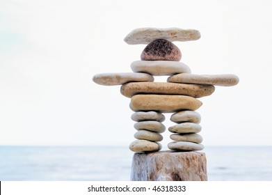 Symbolic figurine is made of pebbles on the shore