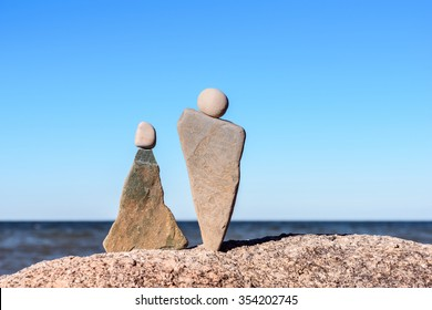 Symbolic figurines of man and woman