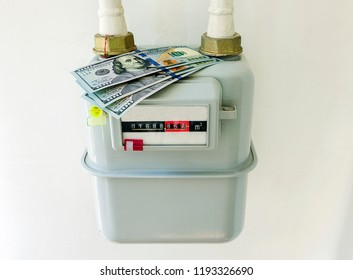 Symbolic image of the cost of natural gas. Gas meter with US dollar bills.