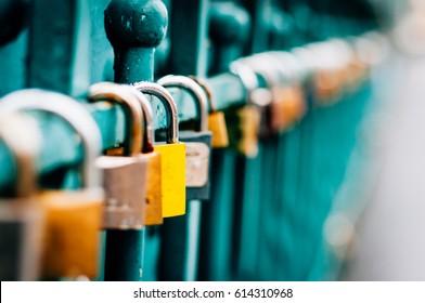 Symbolic love padlocks fixed to the railings of grunwaldzki  bridge, Wroclaw, Poland. Shallow depth of field and creamy bokeh.