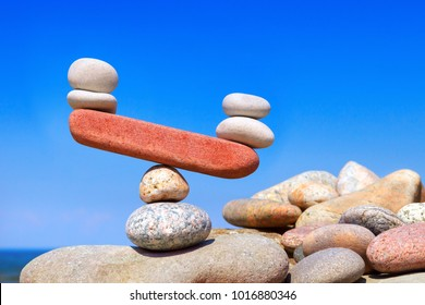 Symbolic scales from stones. The disturbed equilibrium. Imbalance concept