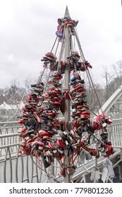 Symbolic tree for locks - wedding tradition and symbol of love. Near the bridge across the river