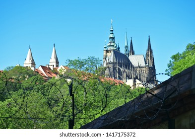 Symbolic view of Prague castle complex behind a  barbed wire representing the fear and hostility of current president Milos Zeman towards people