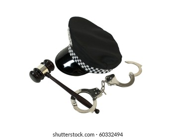 Symbols of authority shown by a black police hat with a set of handcuffs and a wooden gavel - path included