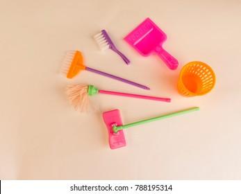 Symbols of cleaning in the nursery - toy MOP, dustpan, bucket, broom