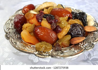 Symbols of the Jewish holiday Tu Bishvat - Dried fruits and nuts. Dried fruits and nuts of Israel