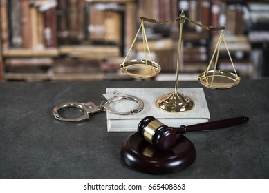 Symbols of the law on a rustic desk