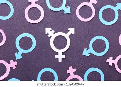Symbols of man, woman and transgender on dark background - Shutterstock ID 1824503447