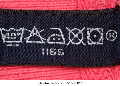 Symbols on label clothes showing as it is necessary to look after these clothes. Close up.