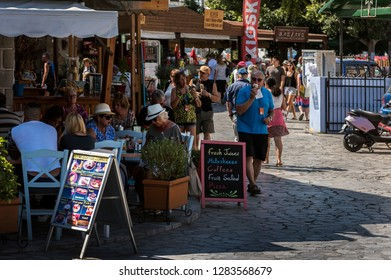 Symi, Dodecanese, Greece. Sept. 28th 2017. Tourists in Symi Town.