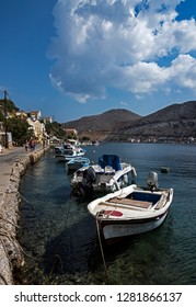 Symi, Dodecanese, Greece. Sept. 30th 2017. Boats moored at the Quayside in Symi Town.