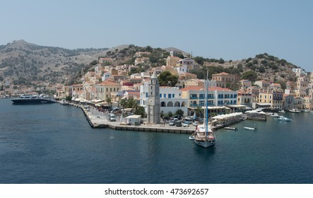 SYMI, GREECE- AUGUST 1: Panoramic image of Symi town with colorful houses on the hill, in the Greek Island of Symi at the Aegean sea on August 1 2016.