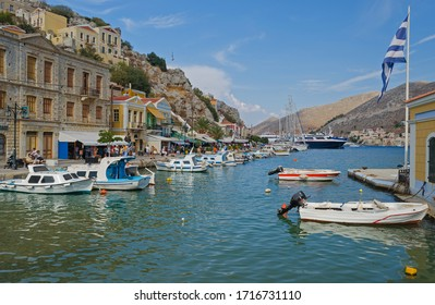 Symi Harbour view with moored fishing boats