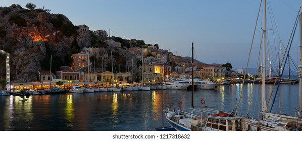 Symi Island, Greece - 7 September , 2017 : Symi Island Harbour view during the twillight.The colorful houses are illuminated by the lights