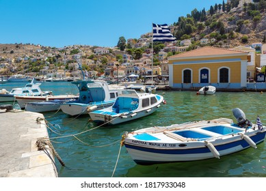 SYMI ISLAND, GREECE -AUGUST 2020: Moored boat at main port of island.