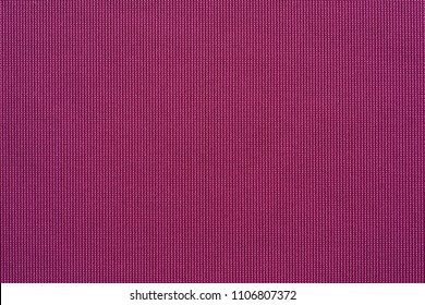 symmetric corrugated macro texture of textile fabric of purple color for wallpaper or for an abstract background