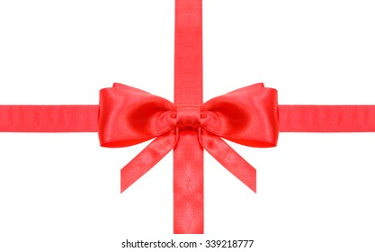 symmetric red bow with vertically cut ends on intersection of two red satin ribbons isolated on white background
