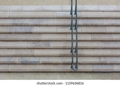Symmetric stone stairs with handrail from above