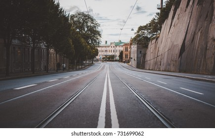 Symmetric tram tracks on a street depth of field in Gothenburg Sweden