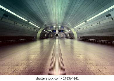 symmetric underground station hall with colored illumination
