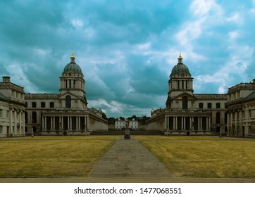 Symmetrical building in Greenwich, London under magnificent sky.