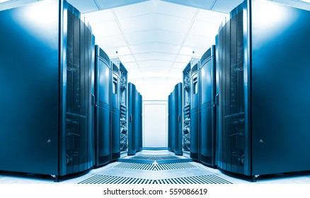 symmetrical data center room with rows of equipment