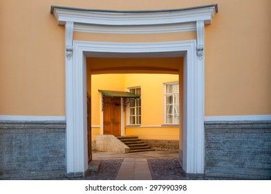 Symmetrical entrance to classical residential house, gateway with door in the end