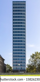 symmetrical front shoot of an office building with blue sky from duesseldorf, germany.