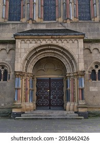 Symmetrical front view of ornamented entrance of historic church Herz-Jesu-Kirche built in Neo-Romanesque style in 1903 with stone columns and windows in the center of Koblenz, Germany. - Shutterstock ID 2018462426