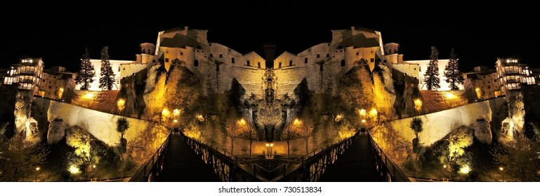 symmetrical night photograph of the city of Cuenca, spain,