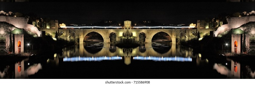 symmetrical night photograph of the medieval bridge of San Martín in illuminated Christmas in Toledo