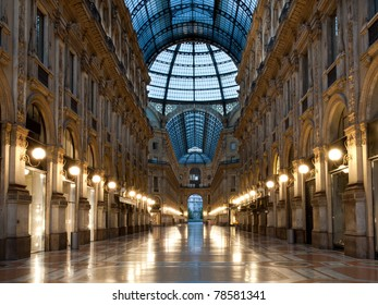 Symmetrical night shot of the hall of the landmark arcade or covered mall, Galleria Vittorio Emanuele II in Milan, Italy
