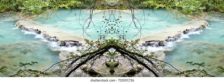 symmetrical photograph of the blue river, the birth of the river Urederra in the Natural Park of Urbasa, Navarra, Spain,