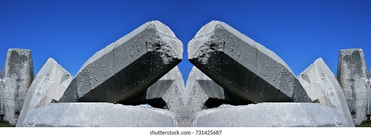 symmetrical photograph of concrete blocks for the construction of dams on the coast.