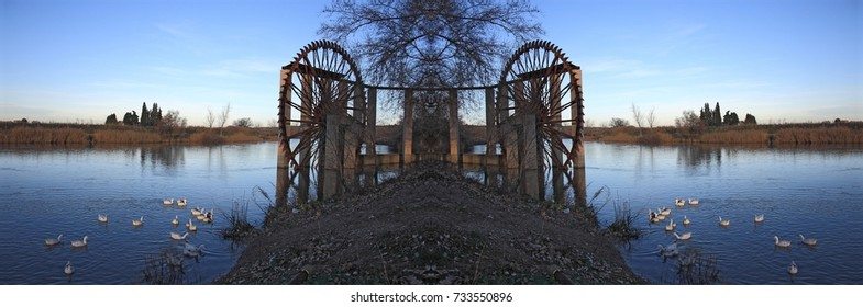 symmetrical photograph of Ferris wheel with ducks on the Tagus River in Toledo, Spain,
