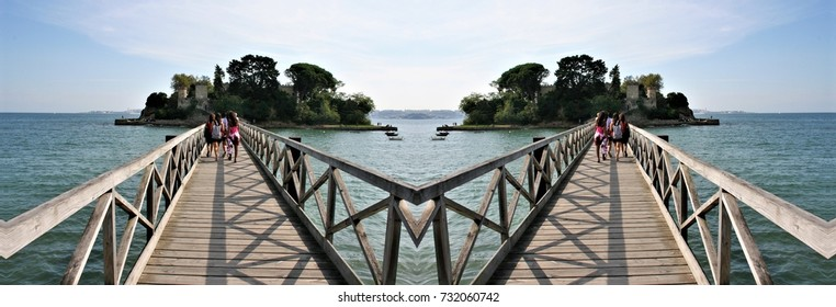 symmetrical photograph of footbridge over the sea on the coast of Galicia, Oleiros, A Coruna Spain