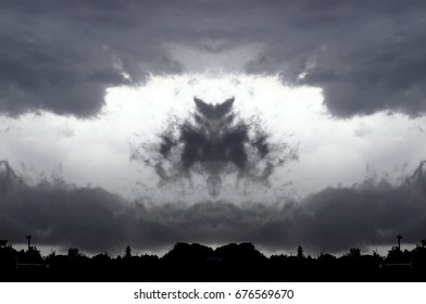 Symmetrical photographs of small black clouds with light background, growth, explode, portent, drama, fear, magical, artistic, landscapes of your mind, just for crazy, optical illusions