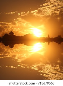 symmetrical photography of reflected sunset,