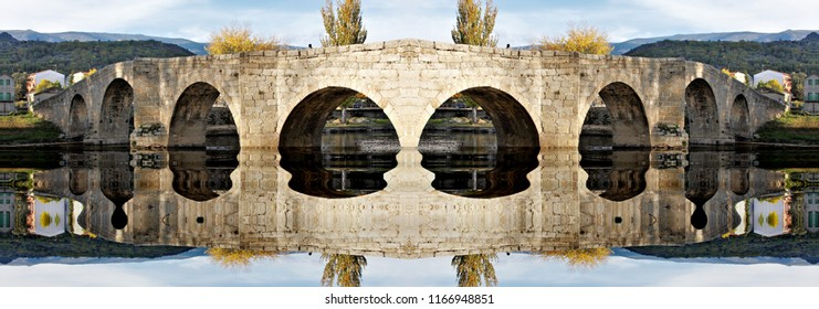 symmetrical photography with reflection in the water of Roman bridge of Navaluenga, Avila, Spain, symmetry,