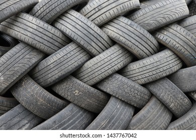 Symmetrical pile of used tires
